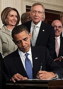 Obama_signs_ObamaCare