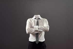 invisible man standing with folded arms over his chest against g