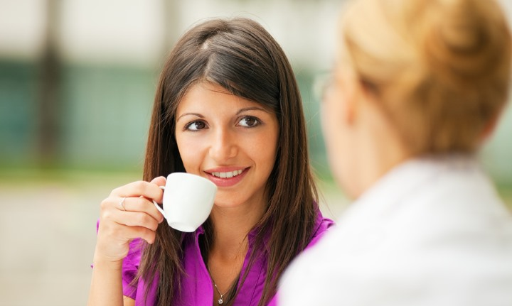 Business Women Discussing While Drinking Coffee - The Objective Standard