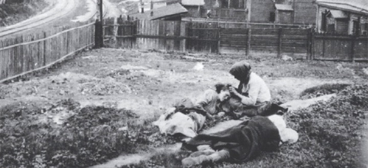 Image: Taken in Kharkiv in 1932-33. Three women have been evicted from their home and are lying in their yard dying of hunger.